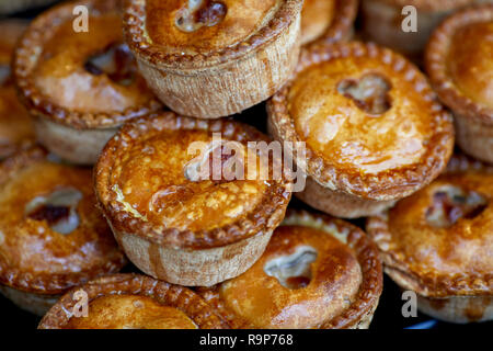 Artisan market stall selling homemade pork pies - Stock Photo