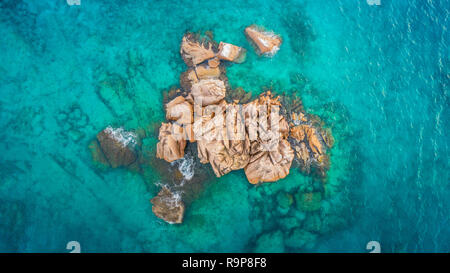 Tropical island with sea and palm taken from drone. Seychelles aerial photo. St Pierre Island - Stock Photo