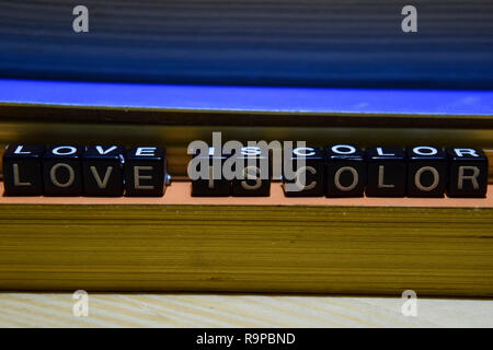 Love is color written on wooden blocks. Education and business concept on wooden background - Stock Photo