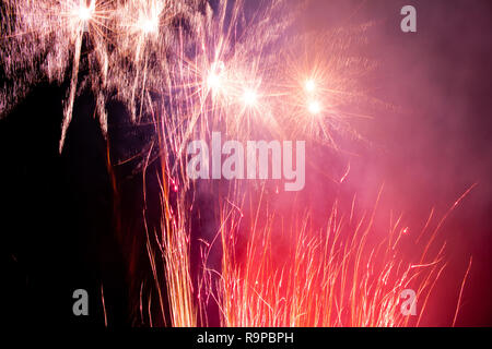 colorful fireworks in the night sky. Celebration lights. - Stock Photo