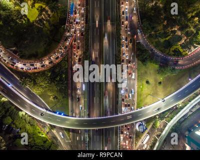 Traffic jam in Jakarta Semanggi flyover bridge during rush hour. - Stock Photo