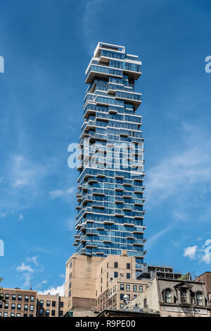New York City, USA - June 25, 2018: Low angle view of modern apartment skyscraper in Tribeca District on 56 Leonard Street also known as Jenga Builidn - Stock Photo