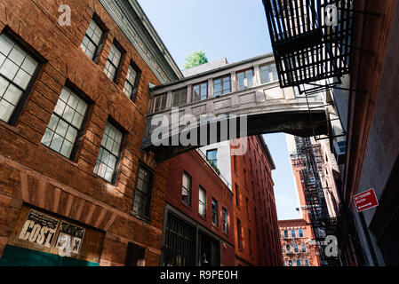 New York City, USA - June 25, 2018: Low angle view of bridge on Staple Street in Tribeca. This alley runs two blocks north between Duane and Harrison  - Stock Photo