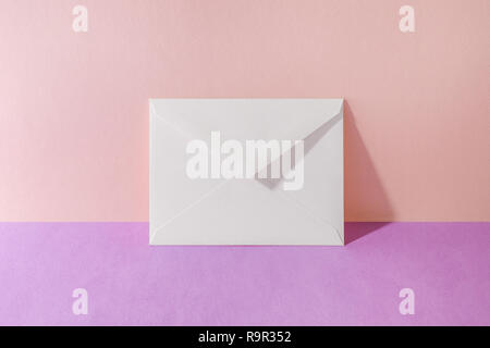 envelope. Pink Two Tone Background. - Stock Photo