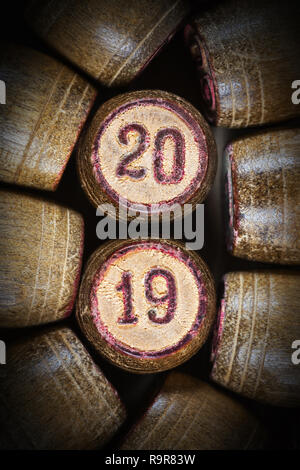 Vintage wooden lotto kegs with two numbers 20 and 19 as symbol of Close-up top view of 2019 New Year inscription in circle with pink trim. 2019 year. - Stock Photo