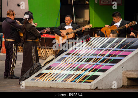 A Mariachi band performing at Plaza Garibaldi in Mexico City, Mexico - Stock Photo