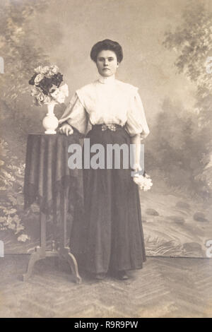 RUSSIA - CIRCA 1905-1910: A portrait of young woman in studio, Vintage Carte de Viste Edwardian era photo - Stock Photo