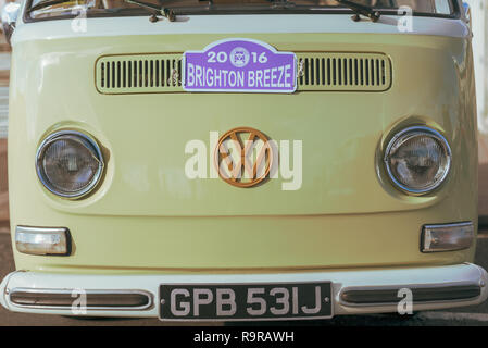 The front of a yellow Volkswagen VW campervan parked in Brighton, Sussex, UK. - Stock Photo
