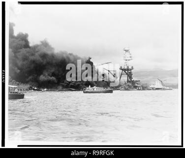 USS Arizona, at height of fire, following Japanese aerial attack on Pearl Harbor, Hawaii, December 7, 1941. (Library of Congress-Farm Security Administration - Office of War Information) - Stock Photo