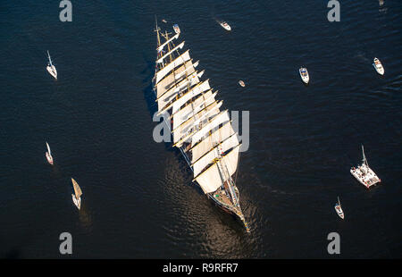 The last windjammer bark Kruzenstern. A large sailboat goes along the water area of the Daugava River. - Stock Photo