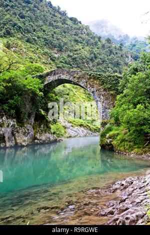 Roman bridge over the River Cares (Puente romano de La Vidre), Trescares, Asturias, Spain - Stock Photo
