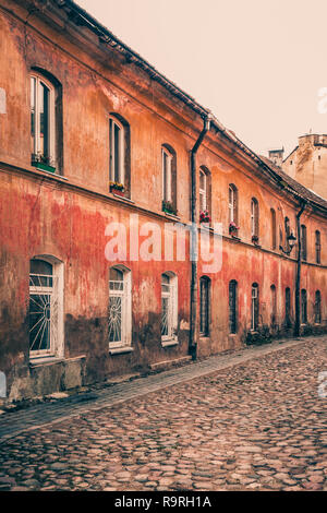 Narrow street and buildings in old town, Vilnius, Lithuania. - Stock Photo