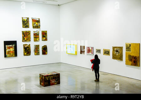Krakow, Poland. 28th Dec, 2018. A woman seen walking front of pieces of art works of Boris Lurie Pop-art after the Holocaust exhibition. Boris Lurie (1924-2008) is an American artist of Jewish origin who was born in Leningrad (today St. Petersburg). In August 1941, the Germans began deporting the local Jewish population to the ghetto in Riga, where Boris Lurie spent his childhood. His Grandmother, mother, sister and beloved were shot in a forest near Rumbuli in the Riga suburbs in December 1941. his work is closely related to this experience during the Holocaust. The motifs appearing in - Stock Photo