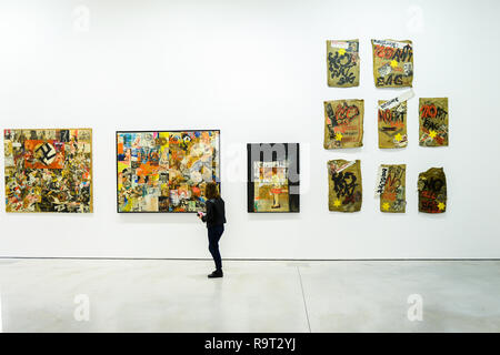 Krakow, Poland. 28th Dec, 2018. A woman seen walking front of art works with Nazi symbols part of Boris Lurie Pop-art after the Holocaust exhibition. Boris Lurie (1924-2008) is an American artist of Jewish origin who was born in Leningrad (today St. Petersburg). In August 1941, the Germans began deporting the local Jewish population to the ghetto in Riga, where Boris Lurie spent his childhood. His Grandmother, mother, sister and beloved were shot in a forest near Rumbuli in the Riga suburbs in December 1941. his work is closely related to this experience during the Holocaust. The motifs - Stock Photo