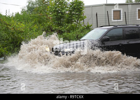 BELGRADE, SERBIA - MAY 15: SUV in flood in Belgrade on MAY 15, 2014. Driving SUV through flooded street after river Sava overflow in Belgrade, Serbia. - Stock Photo