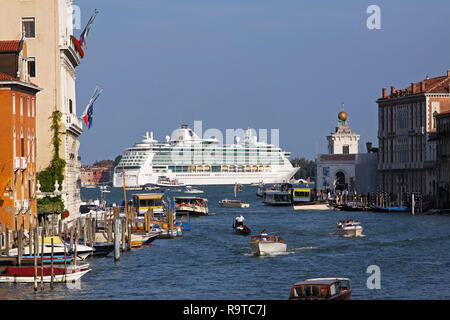 VENICE, ITALY - SEPTEMBER 25: Cruise ship in Venice on SEPTEMBER 25, 2009. Big cruise ship docked in Venice, Italy. - Stock Photo