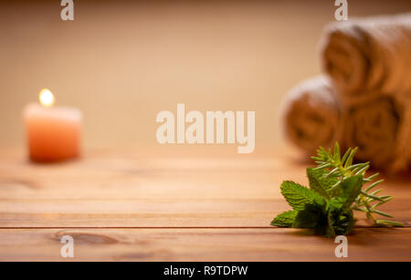Table of a spa with elements, candles and towels out of focus. Relaxing utensils - Stock Photo