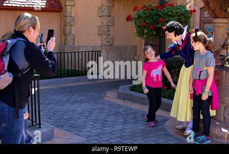 Orlando, FL USA. Feb 2016. Snow White preparing a photo shoot for mom at Disney World. - Stock Photo
