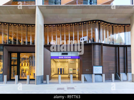 Illuminated name sign at the new entrance to Bank Tube Station under the Bloomberg building in Walbrook, London EC4 - Stock Photo