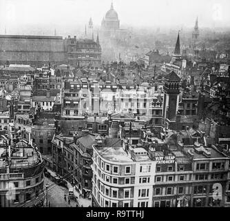Early twentieth century black and white photograph taken from the top of The Monument in Central London, looking West over the rooftops of the city, with St. Pauls Cathedral on the skyline. - Stock Photo
