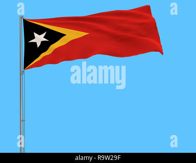 Flag of Democratic Republic of Timor-Leste on the flagpole fluttering in the wind on a blue background, 3d rendering - Stock Photo