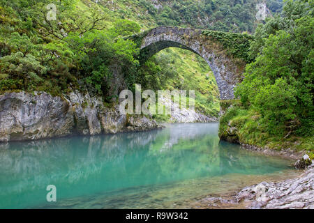 Roman bridge over the River Cares (Puente romano de La Vidre), Trescares, Asturias, Spain - Stock Photo