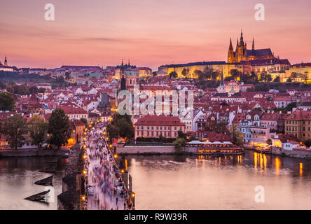 Prague skyline at night with Charles bridge Prague castle and St Vitus cathedral on the hillside of Mala Strana Prague Czech Republic Europe - Stock Photo