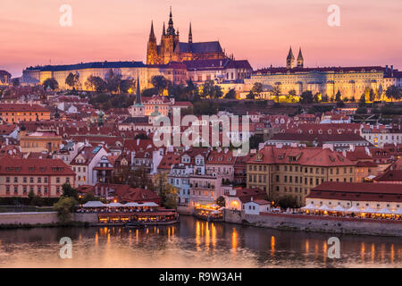 Prague skyline at night with Prague castle and St Vitus cathedral on the hillside of Mala Strana Prague Czech Republic Europe - Stock Photo