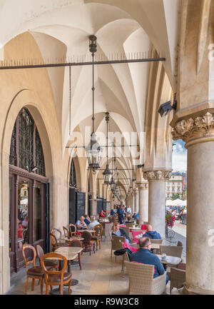 Cafe in the arcade round the Cloth Hall (Sukiennice), Main Square (Rynek Główny), Kraków, Poland - Stock Photo