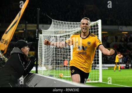Footballer Diogo Jota celebrating a goal with young fan cheering him - Stock Photo
