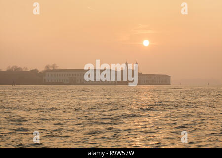 Sunset over San Servolo Island (Isola di San Servolo) in the Venetian Lagoon (Laguna di Venezia) near Venice, Italy. - Stock Photo