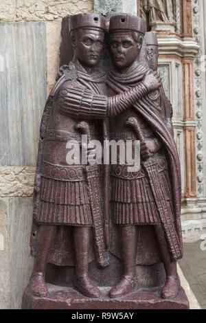 Portrait of the Four Tetrarchs. Porphyry sculptural group of four Roman emperors dated from around 300 AD fixed to a corner of the façade of Saint Mark's Basilica (Basilica di San Marco) in Venice, Italy. - Stock Photo