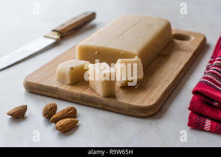 Homemade Almond Paste Whole Marzipan on Wooden Board. Organic Food. - Stock Photo