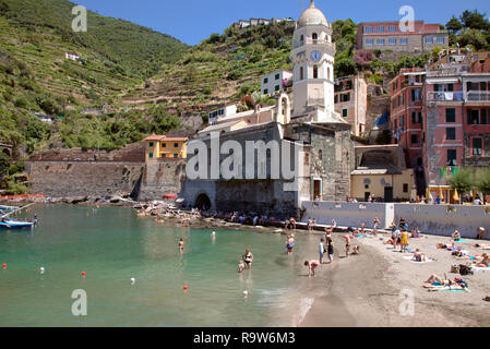 Vernazza and its beach with Santa Margherita d'Antiochia church in the center background, one of five distinctive towns along Italy's Cinque Terre. - Stock Photo