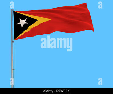 Flag East Timor - Timor-Leste on the flagpole fluttering in the wind on a blue background, 3d rendering - Stock Photo