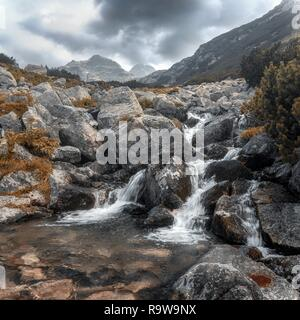 Small mountain waterfall in Malyovitsa district, Rila mountain, Bulgaria - Stock Photo