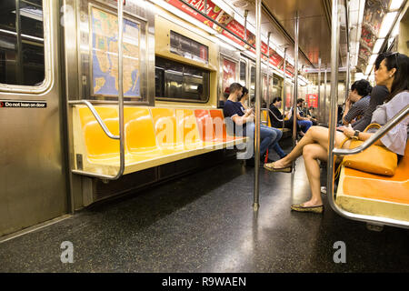 NEW YORK CITY - OCTOBER 6, 2017: View of commuters inside New York City MTA subway train in Manhattan - Stock Photo