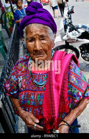 An old Guatemalan woman dressed in traditional dress - Stock Photo