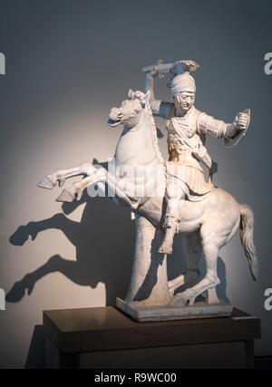 A marble sculpture of a Warrior on horseback. A 2nd cen. AD Roman copy of a 2nd cen BC Greek sculpture. In the National Archaeological Museum at Naple - Stock Photo