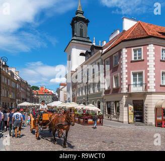 Warsaw, New Town (Nowe Miasto). Horse and carriage ride on Freta street in the New Town district, Warsaw, Poland - Stock Photo