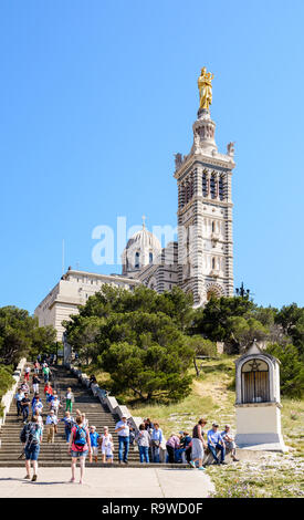 Notre-Dame de la Garde basilica in Marseille, France, accessible by a long sloping pathway with stairs, is very popular with tourists. - Stock Photo