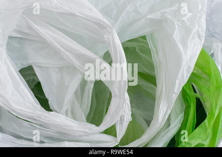 Multiple plastic shopping bags / carrier bags. Metaphor plastic bag tax, bag charge, war on plastic, plastic pollution UK. RM as identifiable colours. - Stock Photo