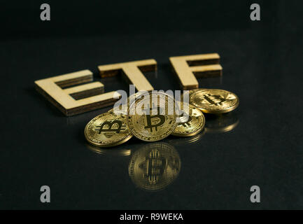 Bitcoin coin with ETF text Put on wooden floor, Concept Entering the Digital Money Fund. - Stock Photo