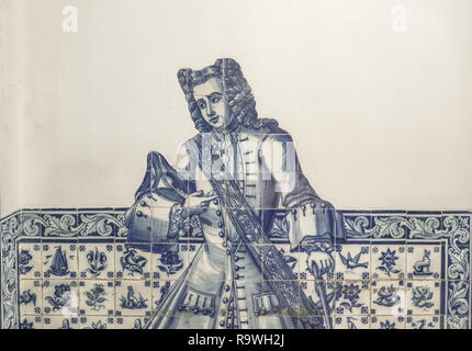 Lisbon - Portugal, gentleman depicted on the facade of an old house with typical hand-painted blue tiles (azulejos) - Stock Photo
