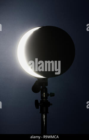 a crescent made of photographic lighting. total lunar eclipse. - Stock Photo