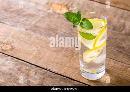 Closeup of fresh water with lemon, mint.