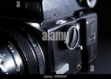 Close up shot of the shutterspeed dial of a vintage medium format film camera. - Stock Photo