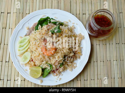 fried rice mixed seafood and pork and glass of fish sauce - Stock Photo