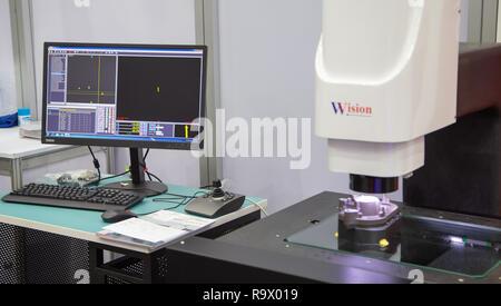 Bangkok, Thailand - November 23, 2018: Vision optical measuring workpiece in Metalex 2018 - Stock Photo