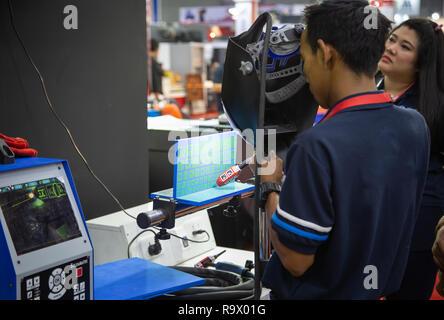 Bangkok, Thailand - November 23, 2018: Operator demonstrate Welding Simulator Soldamatic in Metalex 2018 - Stock Photo